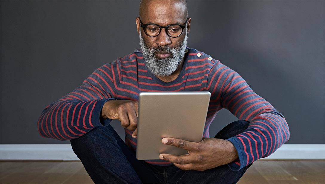 Man looking at a tablet computer.